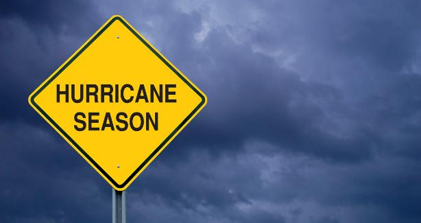 "photograph of a street sign with the words ""hurricane season"""