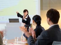 photo of woman giving presentation to small group