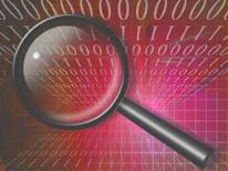 graphic of a magnifying glass over background of computer code